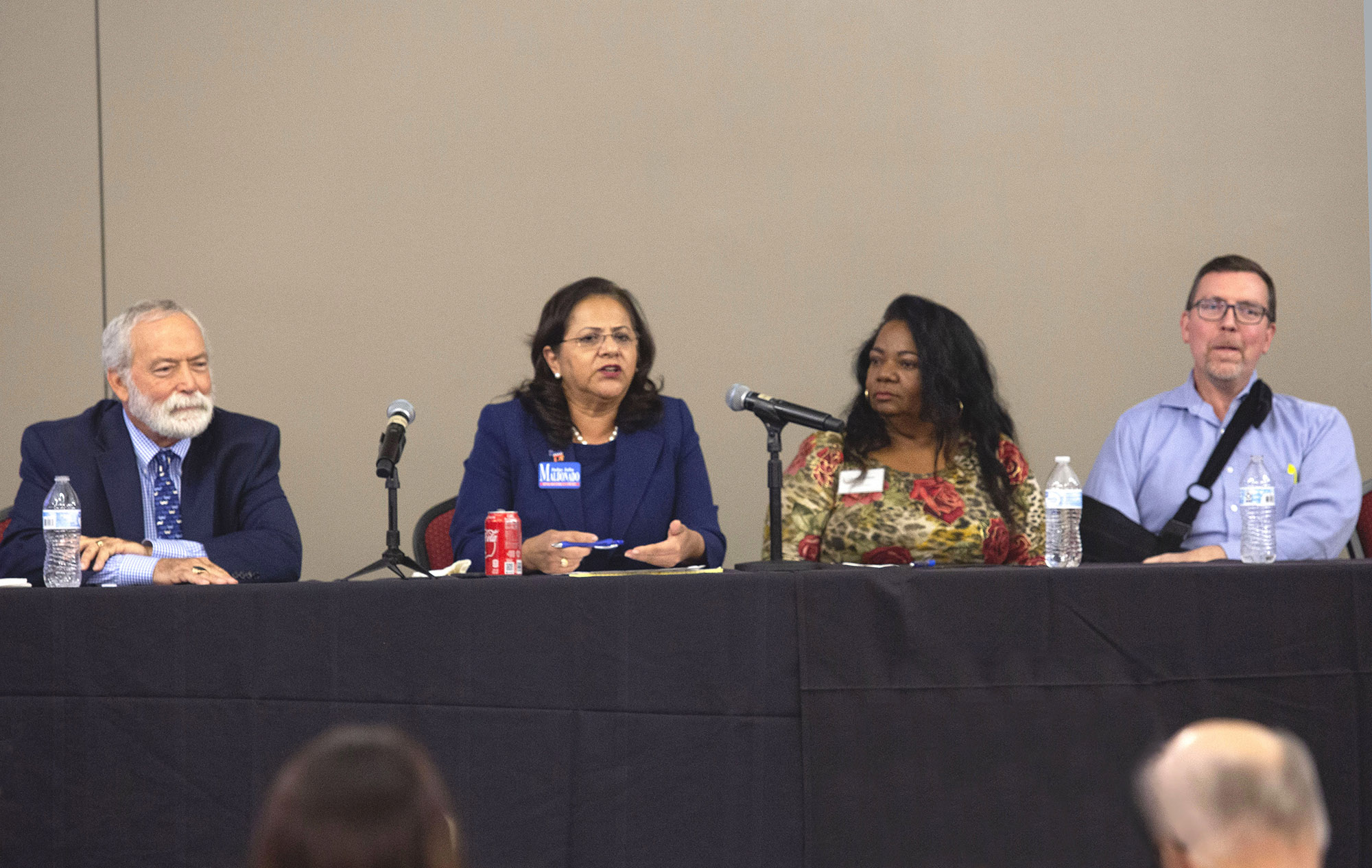 "Harris County District Court judges Clinton ""Chip Wells"", left, Julia Maldonado, Linda Dunson and associate Judge Jim Evans, right, during a panel discussion on the University of Houston campus."